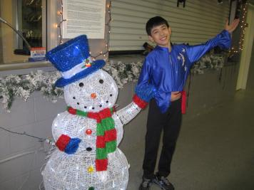 Me posing with a snowman at the Winter Recital.