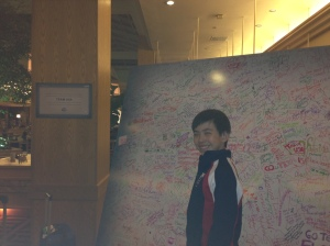 Vincent Zhou signing on the Team U.S.A. autograph board