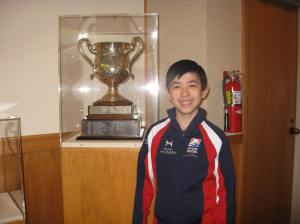 Vincent with the Jr Men National Champion trophy at USFS Museum and Hall of Fame