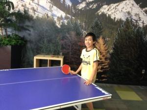 Playing ping pong at break