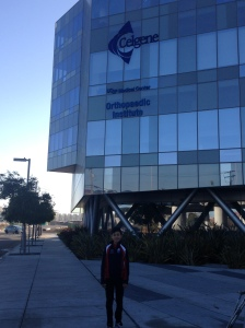 Posing in front of UCSF Orthopedic Institute in my Team USA jacket right before my surgery. I knew it was a journey of challenge, and I just had to face it and be strong.