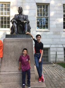 Touching the shoes of the symbolic statue of John Harvard